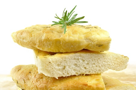 Focaccia with rosemary, olive oil and coarse salt, isolated on white