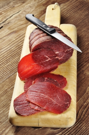 cutting horse: Sliced bresaola on a cutting board;  Stock Photo