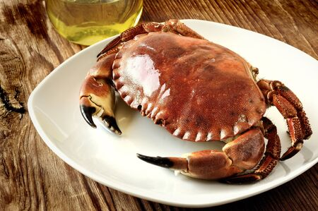 Boiled crab on a old wooden table photo