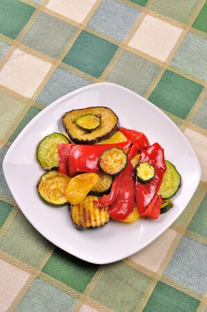 Grilled vegetables on dining table photo