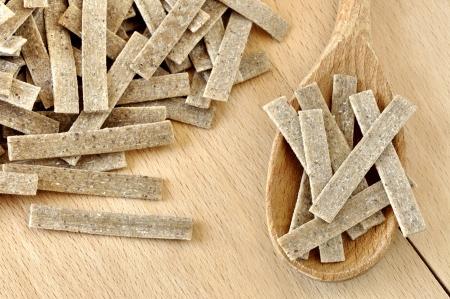 Pizzoccheri on a wooden chopping board, italian pasta, specialty of Valtellina, Italy