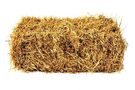 a straw: Hay bale isolated on white