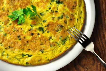 Frittata - italian omelette with parsley and parmesan cheese on a old wooden table Reklamní fotografie - 17111035