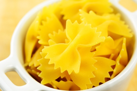 Farfalle, italian raw pasta in a small bowl, selective focus Stock Photo - 17245722