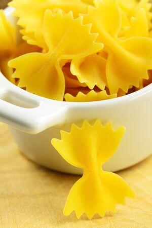 Farfalle, italian raw pasta in a small bowl, selective focus Stock Photo - 17245724