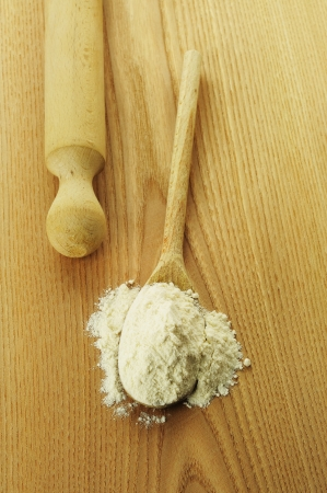 Flour on a wooden chopping board Stock Photo - 17356839