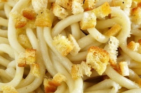 Pici pasta, fresh pasta typical of Tuscany, Italy, closeup photo