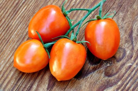 piccadilly: Bunch of Piccadilly tomatoes on a old wooden table