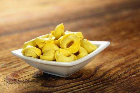 Tortellini, fresh egg pasta, italian food, selective focus Stock Photo