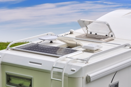 Camper roof with solar panel, antenna, oblo and ladder photo