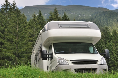 Camper parked at the mountain Stock Photo