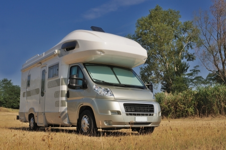 motor home: Camper parked in a countryside in Italy Stock Photo