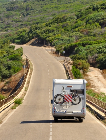 Camper on the road in Sardinia, Italy Stock Photo
