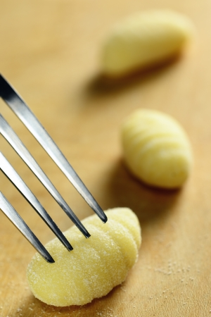 Homemade raw gnocchi, italian fresh pasta, selective focus