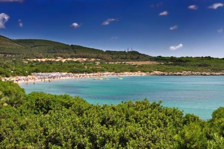 Lazzaretto pláž v Alghero, Sardinie, Itálie