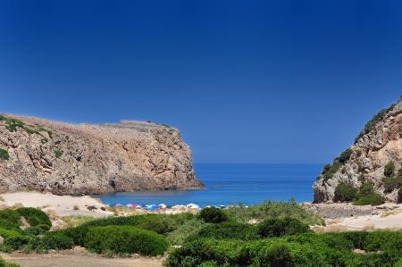Pohled na Cala domestica pláže, město Buggerru, Sardinie, Itálie