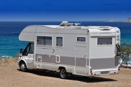 recreational area: Camper parked on the beach in Sardinia, Italy Stock Photo