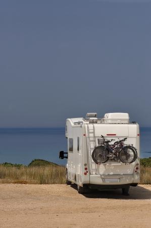 Camper parked on the beach in Sardinia, Italy Archivio Fotografico