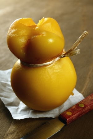 Scamorza, typical italian smoked cheese, on a old wooden table photo