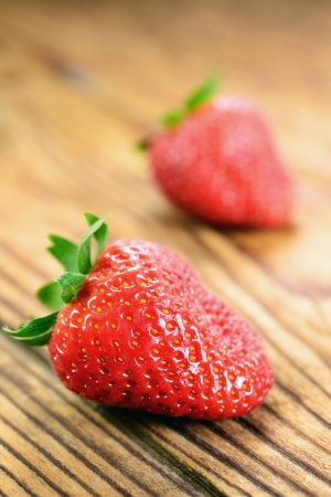 Strawberries on a old wooden table, selective focus