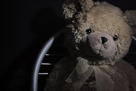 Crying, poor, plush, yellow teddy bear Stok Fotoğraf
