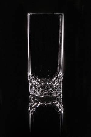 a glass without ornaments, illuminated in low-key in the studio, photo for product purposes.