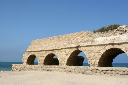 Ruins of an ancient Roman aqueduct build by the Mediterranean Sea on the Israel coast. It was used to transport water from distant mountains to the city area. Stock Photo - 3887229