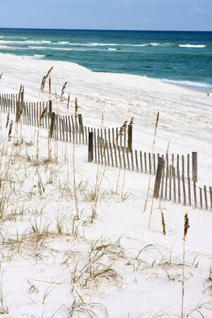 shorelines: Sand fences criss-cross along the beach which help capture sand and create dunes along the Gulf Coast of Florida to prevent hurricane and storm errosion. Stock Photo