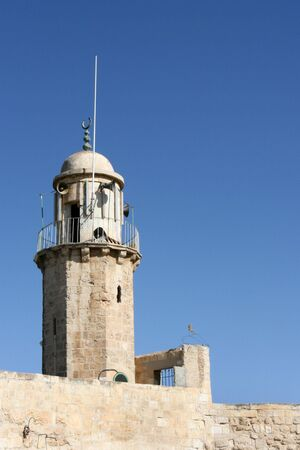 A old Muslim minaret located on the Mount of Olives in the city of Jerusalem, Israel uses megaphones to call Islam worshipers to prayer.