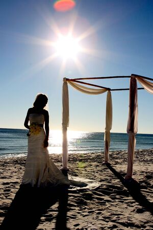 A silhouette of a young beautiful bride as she calmly waits for the ceremony to take place. Stock Photo - 4008561