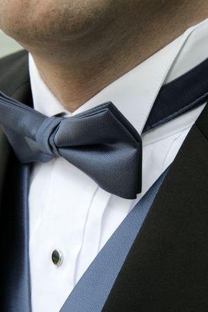 A man wears a blue bowtie, blue vest, white shirt and black formal tuxedo. Stock Photo - 4008560