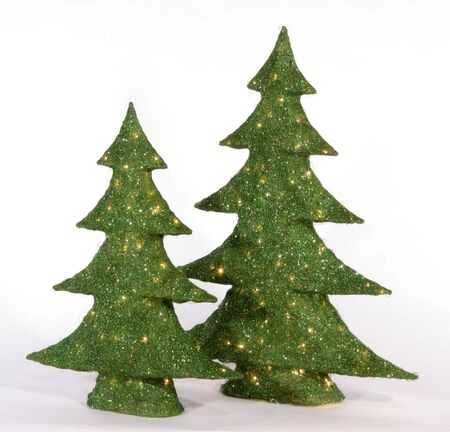 artificial lights: Two green artificial Christmas trees with lights sit on a isolated white background.
