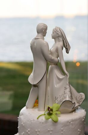 topper: A wedding cake topper depicts a bride and groom dancing.  Stock Photo