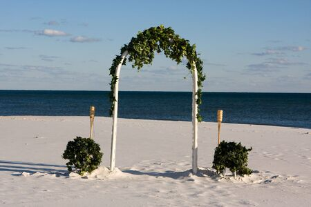 A wedding arch awaits the wedding party at the beach. Stock Photo - 4036968