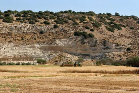 david and goliath: A tractor does modern farming in the Valley of Elah, Israel, the traditional location where David killed Goliath with a slingshot and stone written about in the Old Testament Bible.