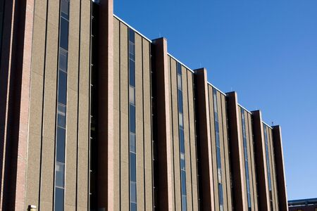 A modern hospital building is shown against a blue sky. Stock Photo - 4121559