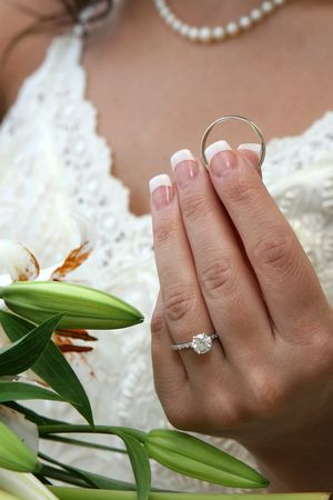 A bride holds the grooms ring moments before the wedding ceremony begins. Stock Photo