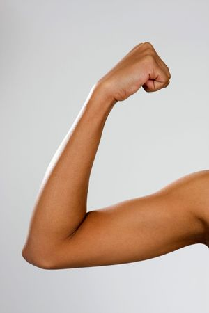 flexed: The biceps brachii muscle of a young, thin African-American woman.