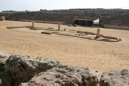 Remnants of the ancient Roman Amphitheater at Caesarea Maritima, Israel, which is located by the Mediterranean Sea, was used as a sports arena and to sacrifice early Christians during the 1st Century. photo