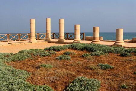 Rebuilt column at the city of Caesarea Maritima, Israel, restored by the Mediterranean Sea. photo