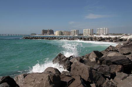 Seaspray blows over the jetty rocks at Destin, Florida. Stock Photo - 4202835