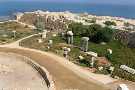 The ruins of the city of Caesarea Maritima, Israel located by the Mediterranean Sea. photo