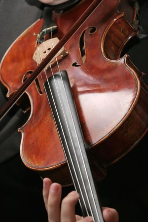 violins: Close up of an old violin being played. Stock Photo