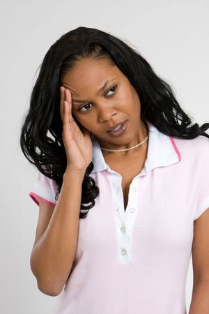 A young African-American woman suffers from headache pain. Stock fotó