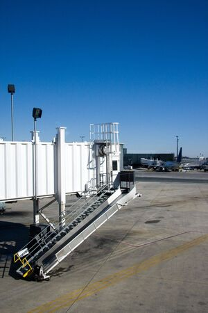 An airport jetway awaits the arrival of an airliner at the terminal. photo