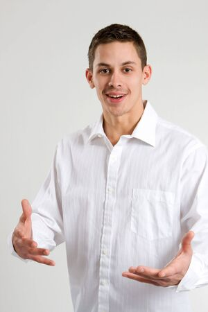 A young man uses body language to explain in the form of a gesture. Stock Photo - 4296569