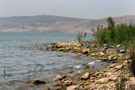 Rocks by the shore of the Sea of Galilee, Israel. Stock Photo