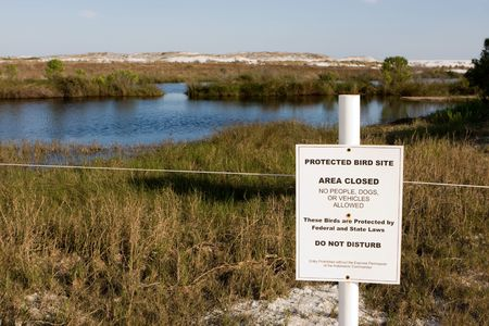 roped off: A posted sign marks an area roped off from public access for a protected bird site in Destin, Florida.