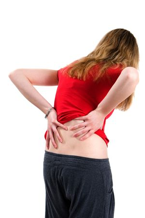back ache: A young woman bends over with back pain.