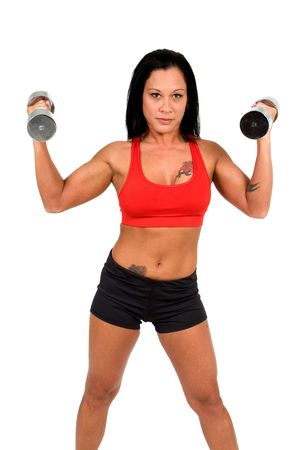 Una fisicoculturista levanta pesas con tatuajes. Foto de archivo - 4941395